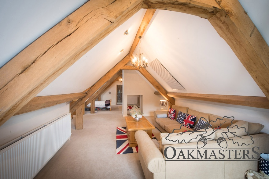 The oak roof structures seamlessly connect individual areas of guest accommodation