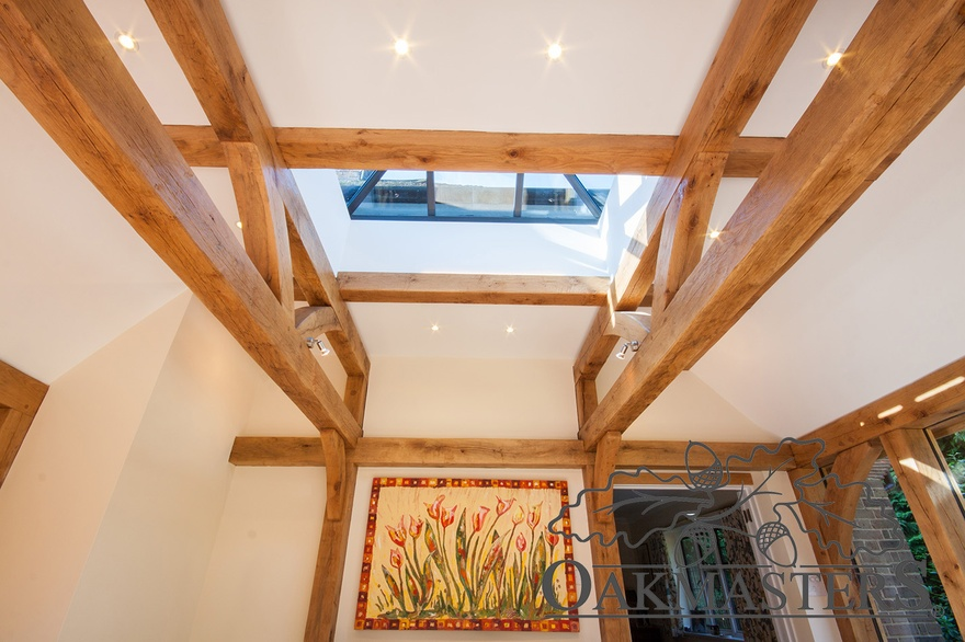 The ceiling is supported with oak half trusses and oak ceiling beams