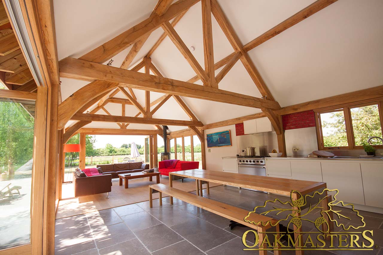 Oak king post trusses create vaulted ceiling in a kitchen extension